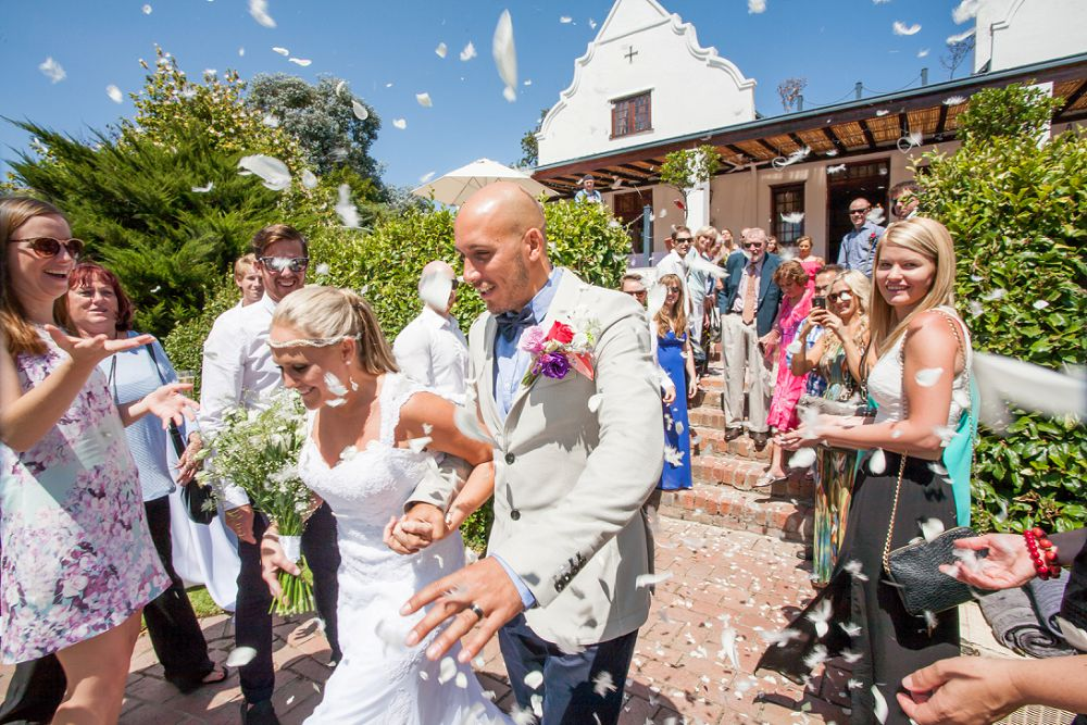 bride and groom showered with feathers