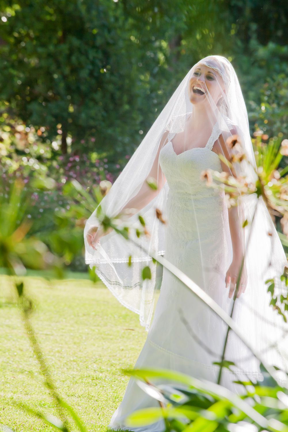 bride playing with veil