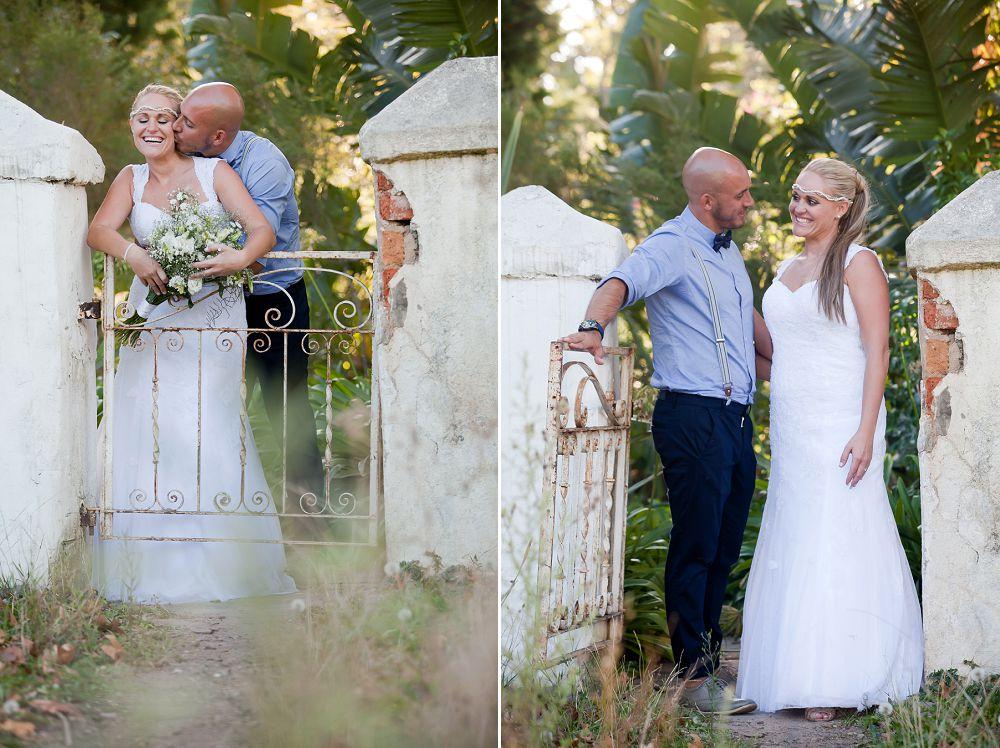 bridal couple against rustic farm wall