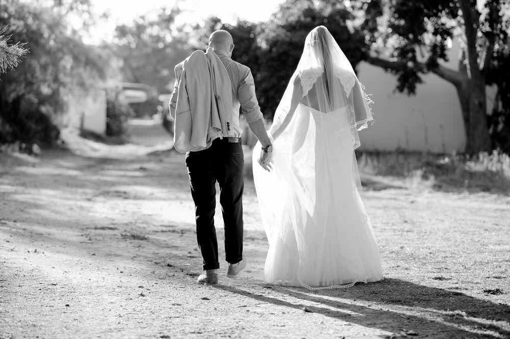 bridal couple walking down road