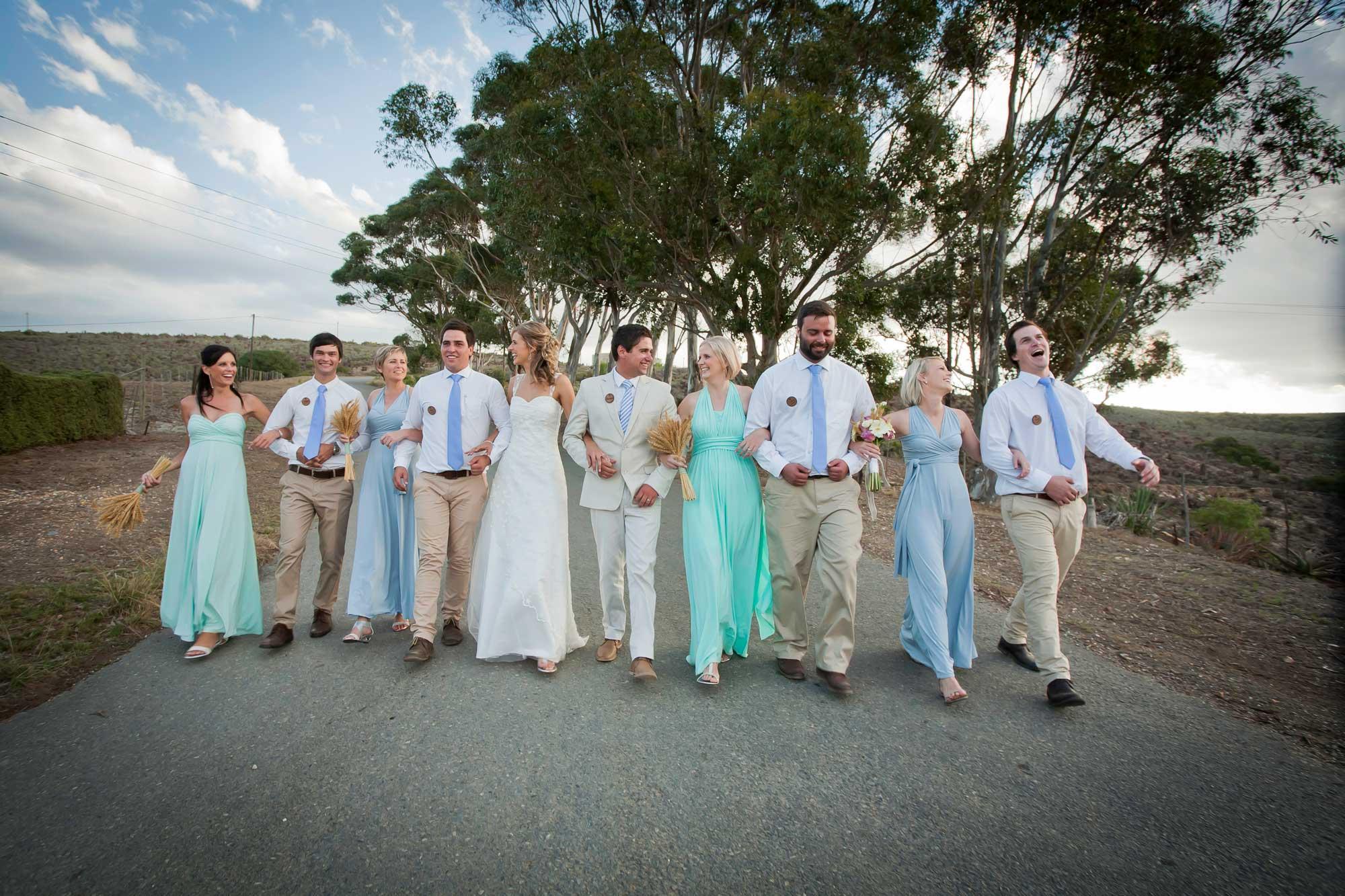 malgas wedding photography bridal party walking in road