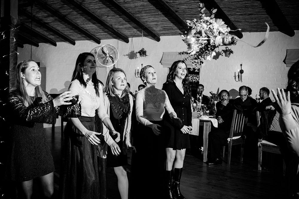 Emotive Wedding photography bouquet toss