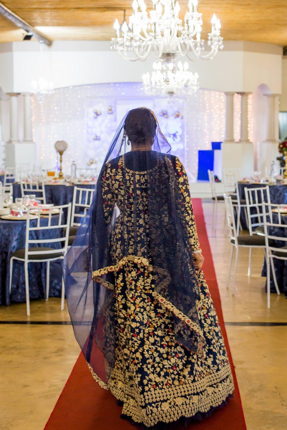 Traditional engagement function bride entering venue