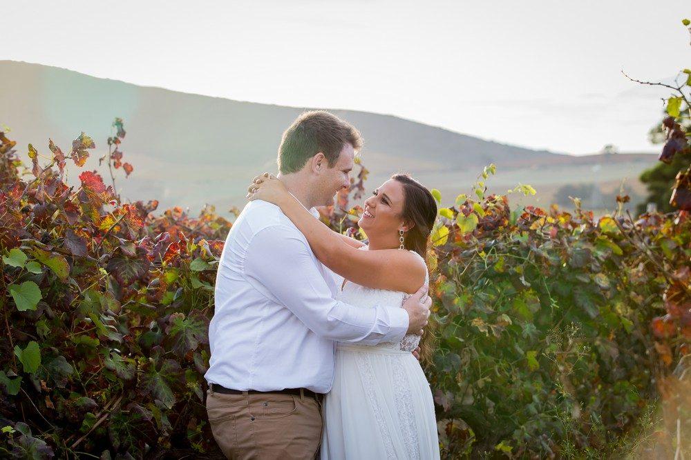 Bride and groom Autumn vineyards Intimate wedding Fransmanshuijs